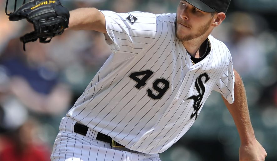 Chicago White Sox starter Chris Sale delivers a pitch during the first inning of a baseball game against the Detroit Tigers in Chicago, Saturday, Aug. 30, 2014. (AP Photo/Paul Beaty)