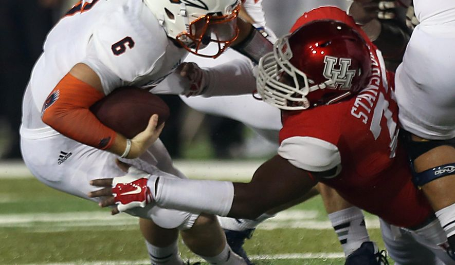 UTSA quarterback Tucker Carter (6) is sacked by Houston defensive end Gavin Stansbury (72) during the second quarter of an NCAA college football game Friday, Aug. 29, 2014, in Houston. (AP Photo/Houston Chronicle, Brett Coomer) MANDATORY CREDIT