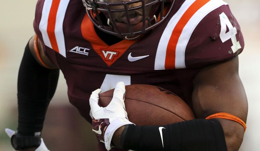 Virginia Tech running back J.C. Coleman scores a touchdown in the fourth quarter  against William & Mary during an NCAA college football game in Blacksburg Va. Saturday, Aug. 30 2014. Virginia Tech won the game 34-9. (AP Photo / The Roanoke Times, Matt Gentry)