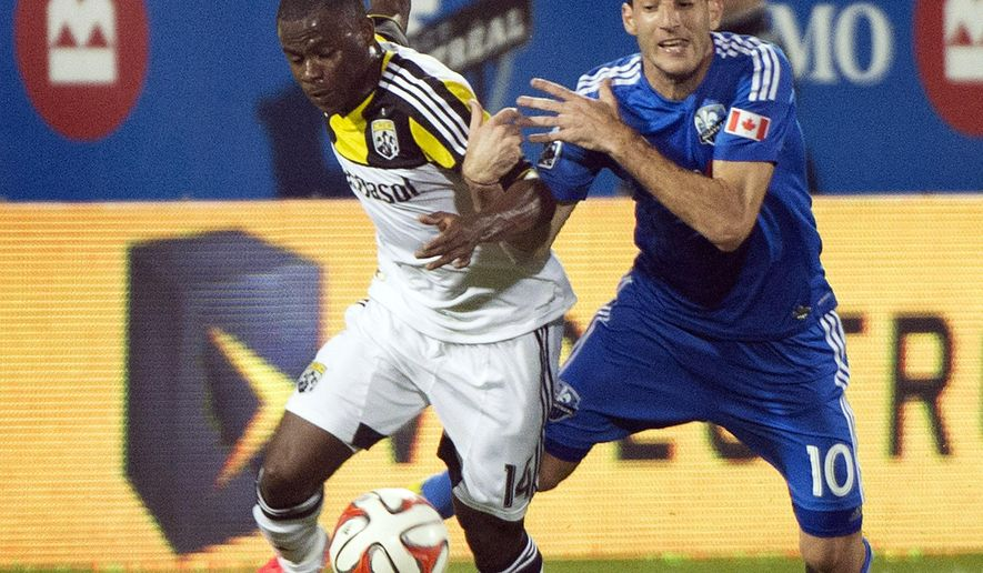 Montreal Impact's Ignacio Piatti, right, and Columbus Crew's Waylon Francis battle for the ball during first half of an MLS soccer game in Montreal, Saturday, Aug. 30, 2014. (AP Photo/The Canadian Press, Graham Hughes)