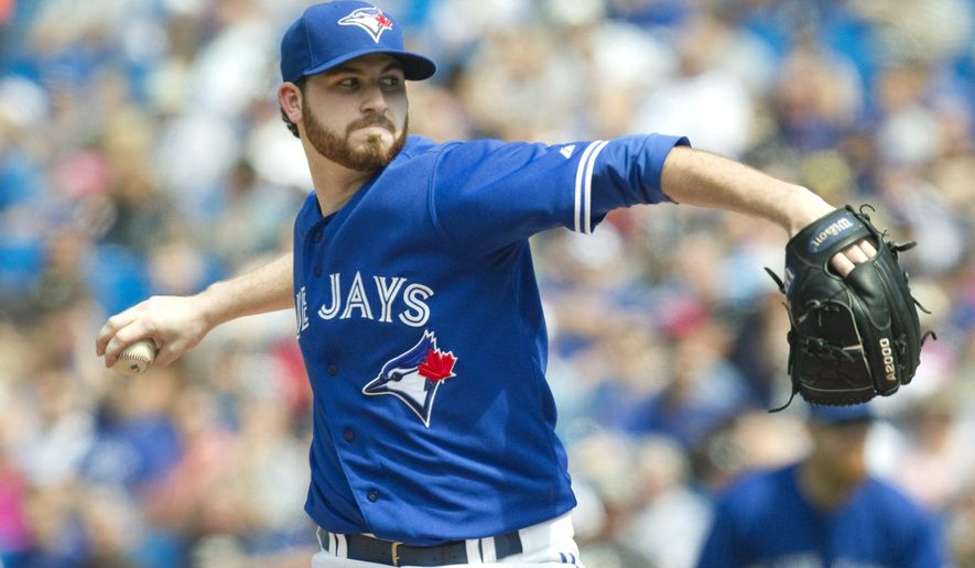 Toronto Blue Jays starting pitcher Drew Hutchison throws against the New York Yankees during the first inning of a baseball game in Toronto on Saturday, Aug. 30, 2014. (AP Photo/The Canadian Press, Fred Thornhill)