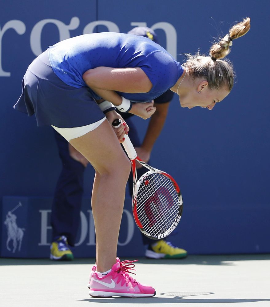 Petra Kvitova, of the Czech Republic, reacts after a shot against Aleksandra Krunic, of Serbia, during the third round of the 2014 U.S. Open tennis tournament, Saturday, Aug. 30, 2014, in New York. (AP Photo/Kathy Willens)