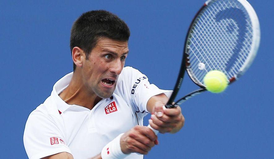 Novak Djokovic, of Serbia, returns a shot against Sam Querrey, of the United States, during the third round of the 2014 U.S. Open tennis tournament, Saturday, Aug. 30, 2014, in New York. (AP Photo/Matt Rourke)