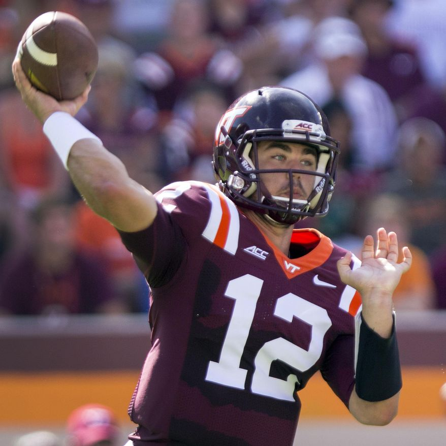 Virginia Tech Quarterback Michael Brewer (12) passes down field during first half action of the Virginia Tech - William & Mary NCAA college football game in Blacksburg, Va. Saturday, Aug. 30, 2014. (AP Photo / The Roanoke Times, Shaban Athuman)