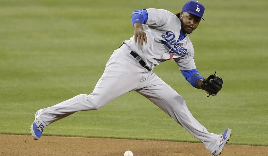 Los Angeles Dodgers shortstop Hanley Ramirez runs down a ground ball on his way to throwing out San Diego Padres' Jedd Gyorko at first during the fourth inning in a baseball game Friday, Aug. 29, 2014, in San Diego. (AP Photo/Gregory Bull)
