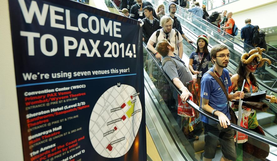Attendees, many in costumes, ride an escalator Friday, Aug. 29, 2014, at the Penny Arcade Expo, a fan-centric celebration of gaming in Seattle. The event is expected to be attended by 85,000 gamers and will include concerts, game tournaments and previews of upcoming titles. (AP Photo/Ted S. Warren)