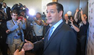 "U.S. Sen. Ted Cruz, R-Texas, speaks to reporters after his speech at the Americans for Prosperity Summit in Dallas on Saturday, Aug. 30, 2014. He told the influential gathering of conservative activists Saturday that ""we are part of a grassroots fire that is sweeping this country."" (AP Photo/Will Weissert)"