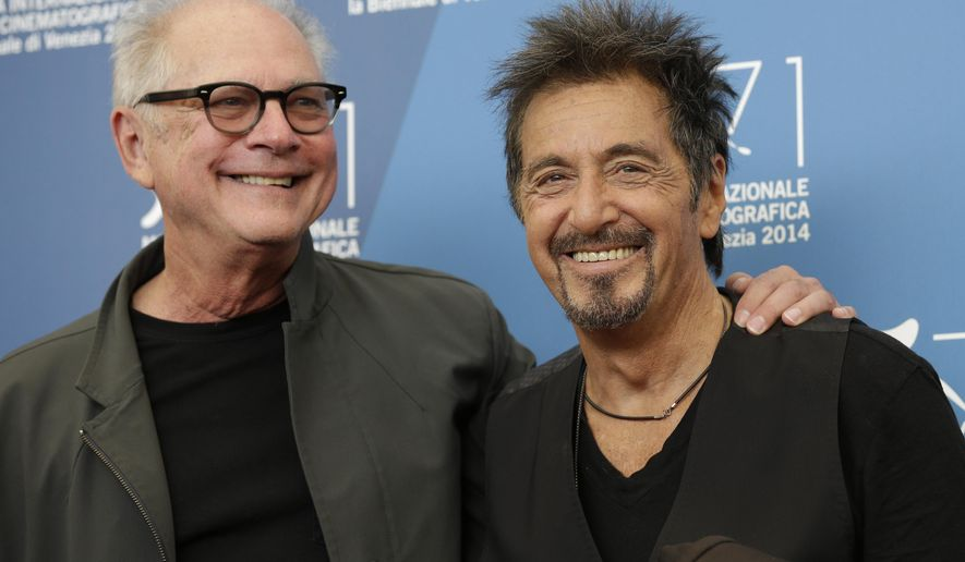 Actor Al Pacino, right, and director Barry Levinson pose during the photo call for the movie 'The humbling' at the 71st edition of the Venice Film Festival in Venice, Italy, Saturday, Aug. 30, 2014. (AP Photo/Andrew Medichini)