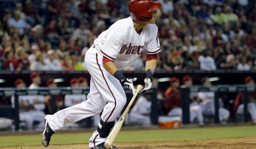 Arizona Diamondbacks' Jake Lamb watches his grand slam against the Colorado Rockies during the eighth inning of a baseball game, Friday, Aug. 29, 2014, in Phoenix. (AP Photo/Matt York)