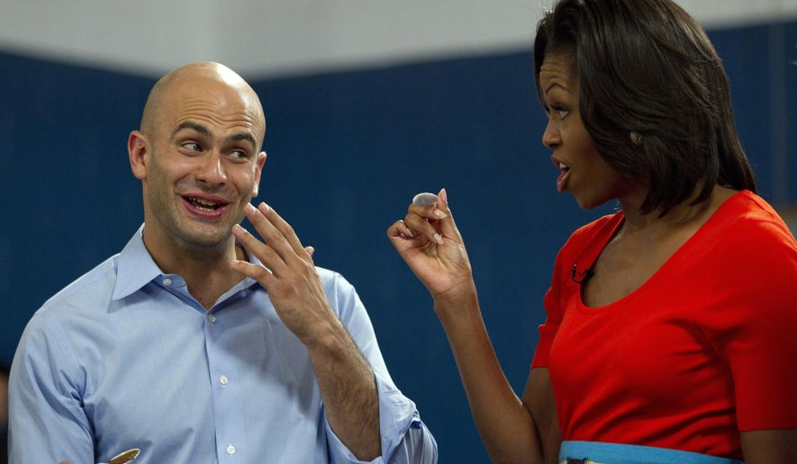 In this Feb. 10, 2012, file photo White House chef Sam Kass and first lady Michelle Obama taste food in Dallas. (AP Photo/Carolyn Kaster, File)