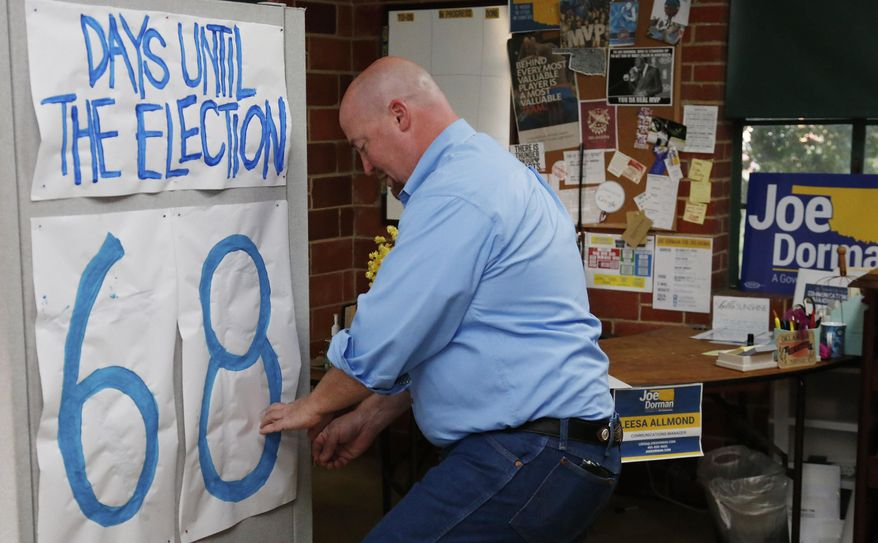 In this Thursday, Aug. 28, 2014 photo, Joe Dorman, Democratic candidate for governor, changes the number on an election countdown calendar in his campaign headquarters in Oklahoma City. (AP Photo/Sue Ogrocki)