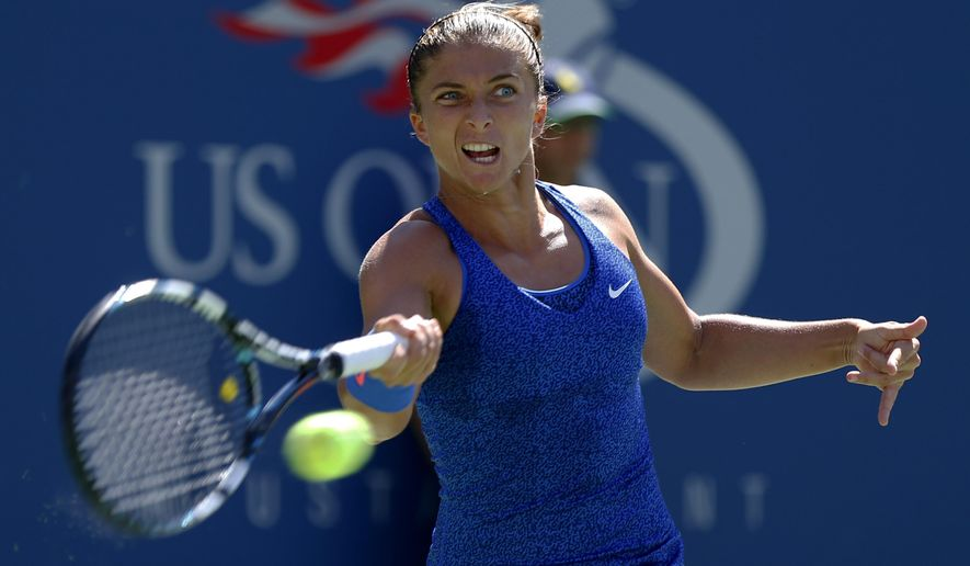 Sara Errani, of Italy, returns a shot against Venus Williams, of the United States, during the third round of the 2014 U.S. Open tennis tournament, Friday, Aug. 29, 2014, in New York. (AP Photo/Matt Rourke)