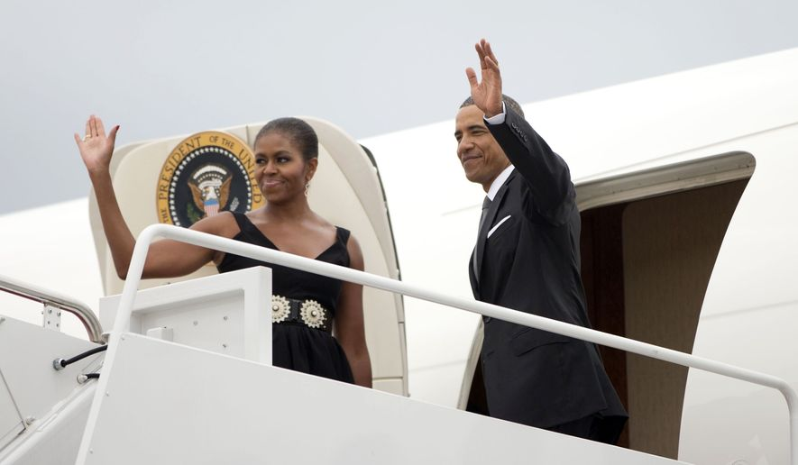 President Barack Obama, right, and first lady Michelle Obama board Air Force One before their departure from Andrews Air Force Base, Saturday, Aug. 30, 2014. The first family is attending the wedding of Sam Kass, their longtime family chef. The bride is MSNBC host Alex Wagner. The wedding is at a farm-to-table restaurant in Westchester County, north of New York City. (AP Photo/Pablo Martinez Monsivais)