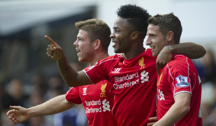 Liverpool's Raheem Sterling, center, celebrates with teammates Joe Allen, right, and Alberto Moreno after scoring against Tottenham Hotspur, during their English Premier League soccer match at White Hart Lane, London, Sunday, Aug. 31, 2014 (AP Photo/Bogdan Maran)