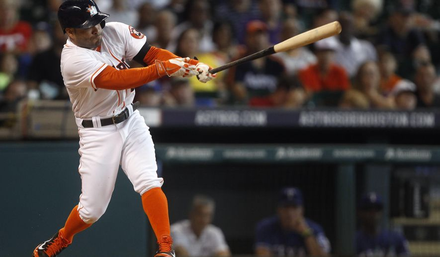 Houston Astros' Jose Altuve hits a double to left field during the third inning of a baseball game against the Texas Rangers, Sunday, Aug. 31, 2014, in Houston. (AP Photo/Patric Schneider)