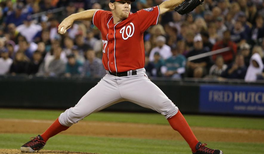 Washington Nationals starting pitcher Stephen Strasburg throws against the Seattle Mariners in the eighth inning of a baseball game, Saturday, Aug. 30, 2014, in Seattle. Strasburg was the winning pitcher as the Nationals beat the Mariners 3-1. (AP Photo/Ted S. Warren)