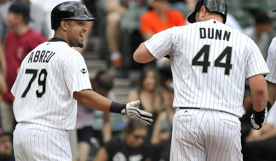 Chicago White Sox's Jose Abreu (79) celebrates with teammate Adam Dunn (44) after Dunn hit a two-run home run during the third inning in the first baseball game of a doubleheader against the Detroit Tigers in Chicago, Saturday, Aug. 30, 2014. Chicago won 6-3. (AP Photo/Paul Beaty)
