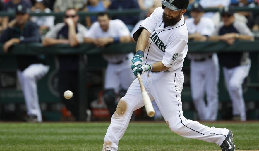 Seattle Mariners' Dustin Ackley hits a three-run home run in the fifth inning of a baseball game against the Washington Nationals, Sunday, Aug. 31, 2014, in Seattle. (AP Photo/Ted S. Warren)