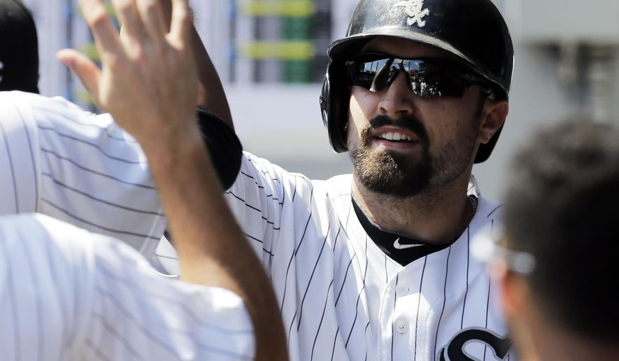 Chicago White Sox's Adam Eaton (1) celebrates with teammates after scoring on a single hit by Conor Gillaspie during the first inning of a baseball game against the Detroit Tigers in Chicago, Sunday, Aug. 31, 2014. (AP Photo/Nam Y. Huh)
