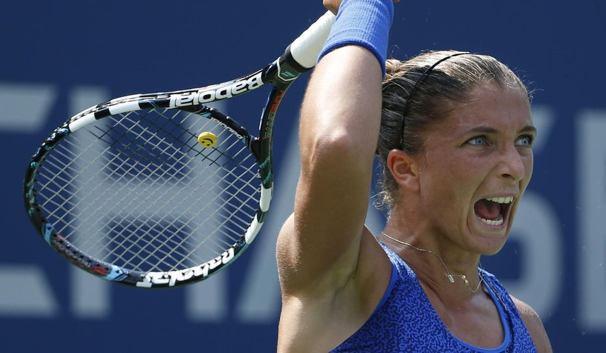 Sara Errani, of Italy, returns a shot against Mirjana Lucic-Baroni, of Croatia, during the fourth round of the 2014 U.S. Open tennis tournament, Sunday, Aug. 31, 2014, in New York. (AP Photo/Kathy Willens)