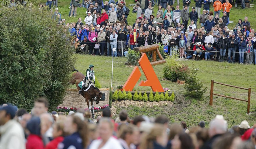 Sarah Ennis of Ireland, riding Horseware Stellor Reboun during the cross-country test of the Eventing competition at the FEI World Equestrian Games, at the French National Stud, in Le Pin-au-Haras, western France, Saturday, Aug. 30, 2014. William Fox-Pitt of Great Britain on Chilli Morning won the cross-country test ahead of Germans Sandra Auffarth on Opgun Louvo and Michael Jung Fischerrocana. (AP Photo/Michel Euler)