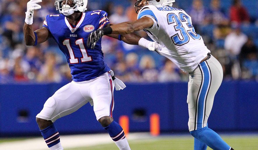 Detroit Lions cornerback Chris Greenwood (33) breaks up a pass intended for Buffalo Bills wide receiver T.J. Graham (11) during the second half of a preseason NFL football game, Thursday, Aug. 28, 2014, in Orchard Park, N.Y. (AP Photo/Bill Wippert)