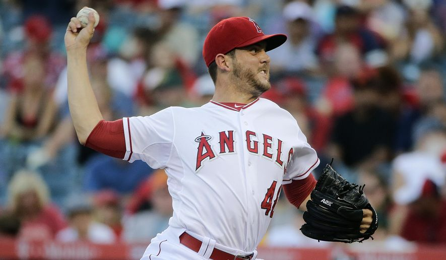 Los Angeles Angels starting pitcher Cory Rasmus throws against the Oakland Athletics during the first inning of a baseball game Saturday, Aug. 30, 2014, in Anaheim, Calif. (AP Photo/Jae C. Hong)