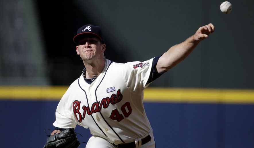 Atlanta Braves starting pitcher Alex Wood throws in the first inning of a baseball game against the Miami Marlins, Sunday, Aug. 31, 2014, in Atlanta. (AP Photo/David Goldman)