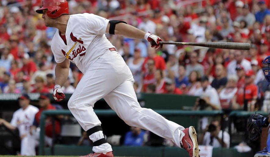 St. Louis Cardinals' Matt Holliday follows through on a two-run single during the eighth inning of a baseball game against the Chicago Cubs, Sunday, Aug. 31, 2014, in St. Louis. The Cardinals won 9-6. (AP Photo/Jeff Roberson)