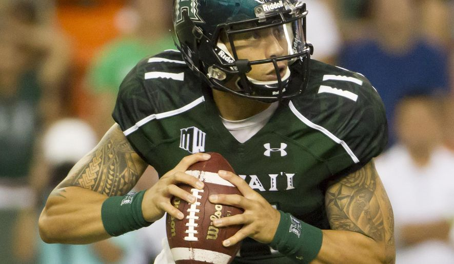 Hawaii quarterback Ikaika Woolsey rolls out to pass in the third quarter of an NCAA college football game, Saturday, Aug. 30, 2014, in Honolulu. (AP Photo/Eugene Tanner)