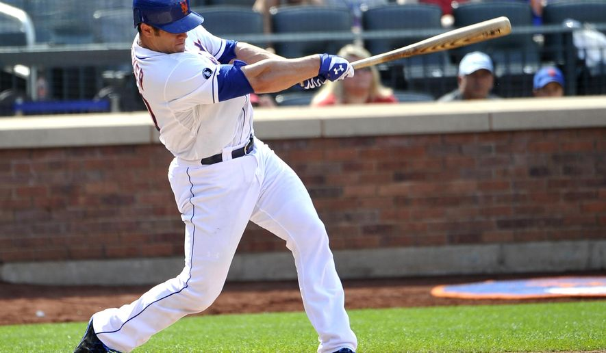 New York Mets' Anthony Recker hits a three-run home run off of Philadelphia Phillies starting pitcher A.J. Burnett in the sixth inning of a baseball game on Sunday, Aug. 31 2014, in New York. (AP Photo/Kathy Kmonicek)