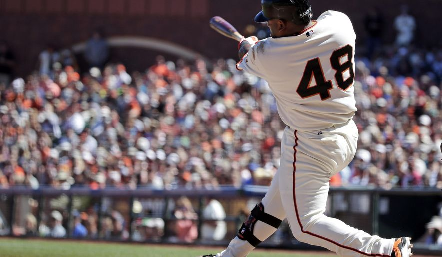 San Francisco Giants' Pablo Sandoval hits a two-run home run against the Milwaukee Brewers during the fifth inning of a baseball game on Sunday, Aug. 31, 2014, in San Francisco. (AP Photo/Marcio Jose Sanchez)