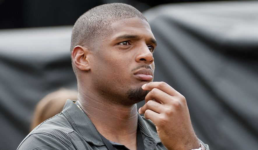 Former Missouri player Michael Sam watches pregame festivities before the start of the South Dakota State-Missouri NCAA college football game Saturday, Aug. 30, 2014, in Columbia, Mo. The St. Louis Rams cut Michael Sam, the first openly gay player drafted by an NFL team. Coach Jeff Fisher repeated over and over that it was purely a football decision. (AP Photo/L.G. Patterson)