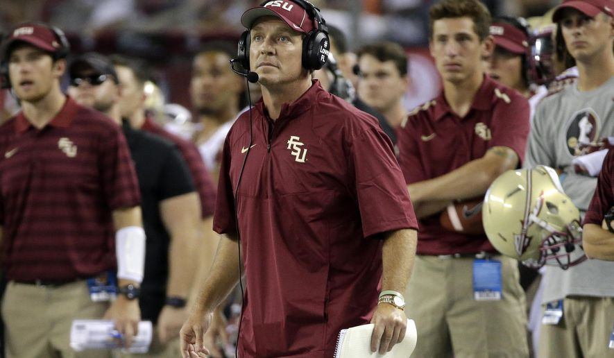 Florida State coach Jimbo Fisher watches an extra point by his team against Oklahoma State in the second half of an NCAA college football game, Saturday, Aug. 30, 2014, in Arlington, Texas. (AP Photo/Tony Gutierrez)