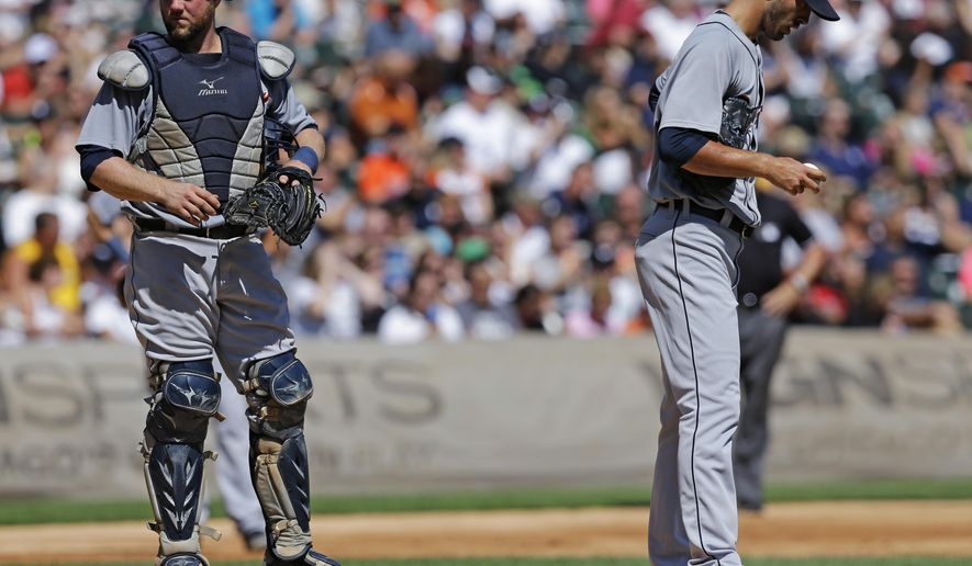 Detroit Tigers starter Rick Porcello, right, and catcher Bryan Holaday react after Chicago White Sox's Avisail Garcia hit a one-run single during the second inning of a baseball game in Chicago, Sunday, Aug. 31, 2014. (AP Photo/Nam Y. Huh)