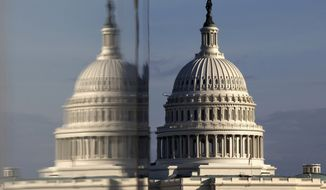 This Jan. 8, 2013, file photo shows the Capitol reflected in the windows of the Newseum, on Pennsylvania Avenue in Washington. (AP Photo/Jacquelyn Martin, File)