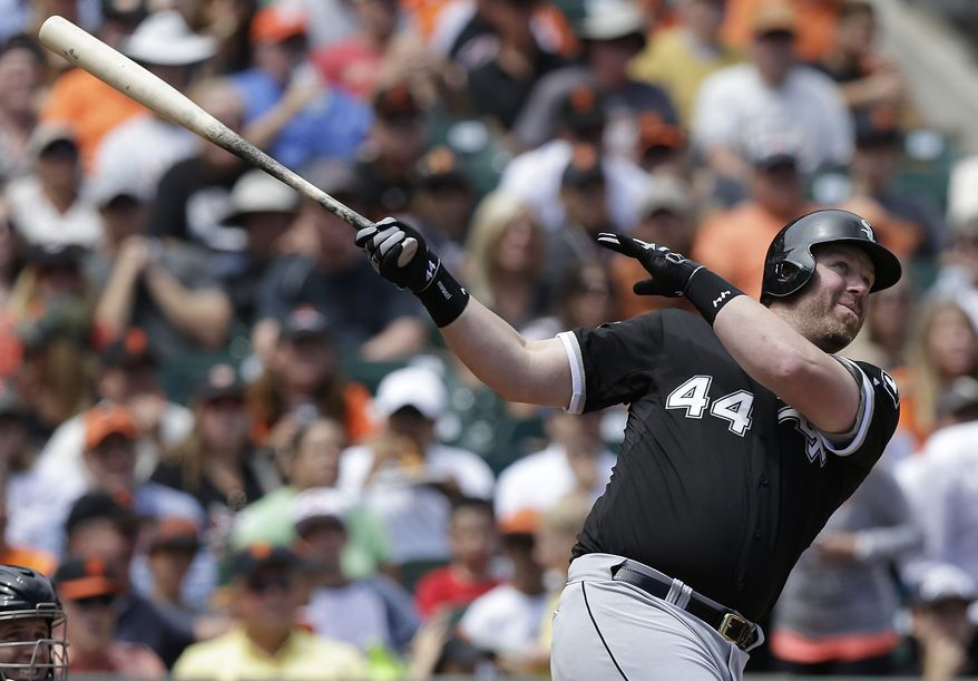 Chicago White Sox's Adam Dunn hits a solo home run off of San Francisco Giants pitcher Jake Peavy during the fourth inning of a baseball game in San Francisco, Calif., Wednesday, Aug. 13, 2014. (AP Photo/Jeff Chiu)