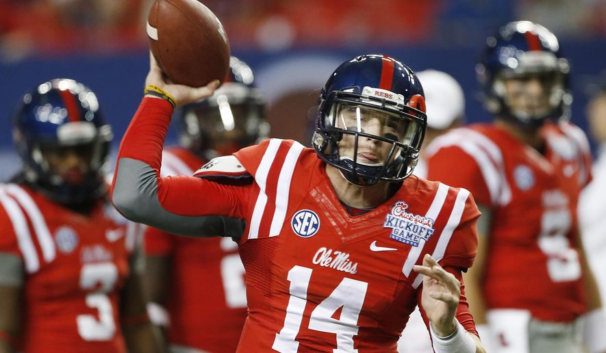 Mississippi quarterback Bo Wallace (14) warms up before the first half of an NCAA college football game against Boise State Thursday, Aug. 28, 2014, in Atlanta. (AP Photo/John Bazemore)