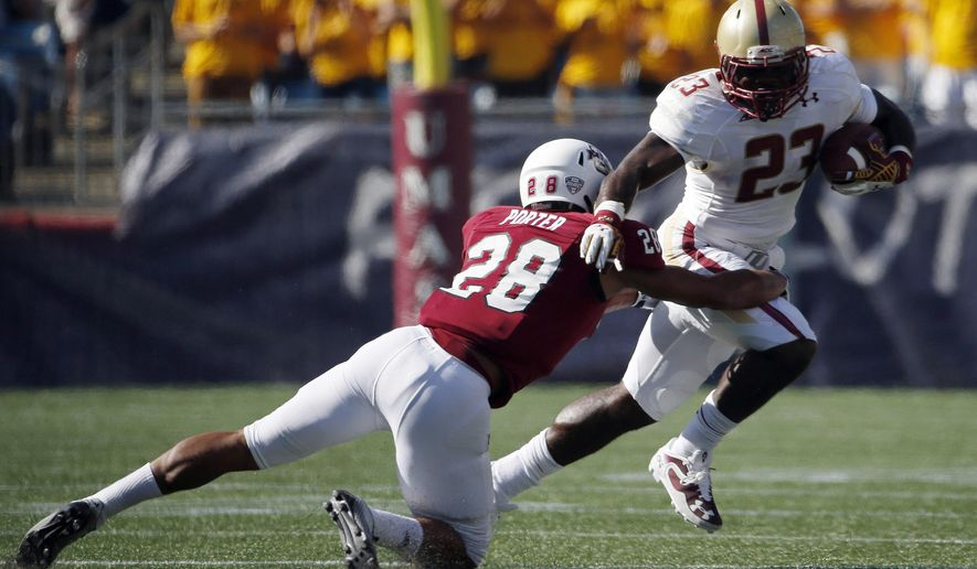 Massachusetts defensive back Jackson Porter (28) tackles Boston College running back Myles Willis (23) during the second quarter of an NCAA college football game in Foxborough, Mass., Saturday, Aug. 30, 2014. Boston College won 30-7. (AP Photo/Michael Dwyer)