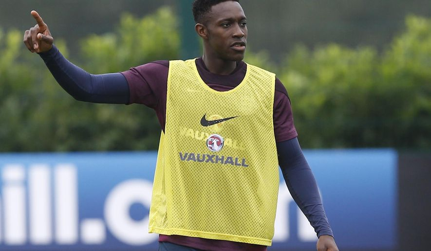 England's Danny Welbeck points during a training session at London Colney, Monday, Sept. 1, 2014. England will play Norway in an international friendly soccer match at Wembley Stadium on Wednesday. (AP Photo/Kirsty Wigglesworth)