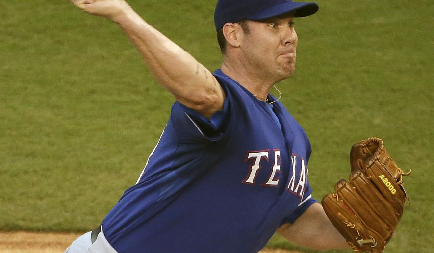 Texas Rangers starting pitcher Colby Lewis throws during the first inning of a baseball game against the Kansas City Royals Monday, Sept. 1, 2014, in Kansas City, Mo. (AP Photo/Charlie Riedel)