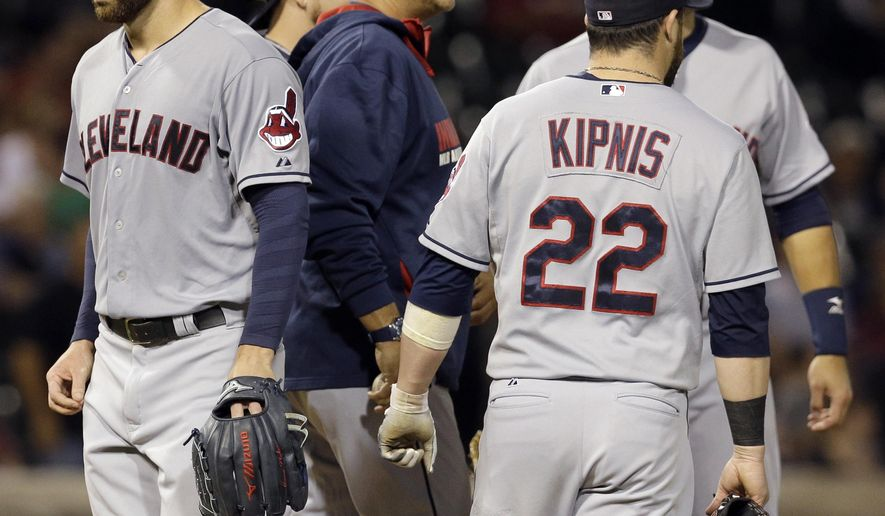 Cleveland Indians starter Corey Kluber, left, is taken out of the game by manager Terry Francona during the seventh inning of a baseball game against the Chicago White Sox in Chicago, Wednesday, Aug. 27, 2014. (AP Photo/Nam Y. Huh)