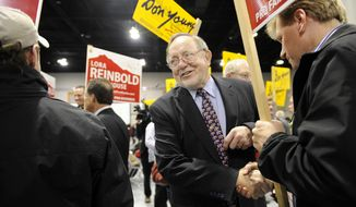 File - This Nov. 6, 2012 file photo shows Rep. Don Young, center, greeting supporters at Election Central while celebrating his re-election at the Dena'ina Center in Anchorage, Alaska. Young, the longest serving Republican in the U.S. House, will be challenged by Democrat Forrest Dunbar. (AP Photo/Anchorage Daily News, Marc Lester, file)