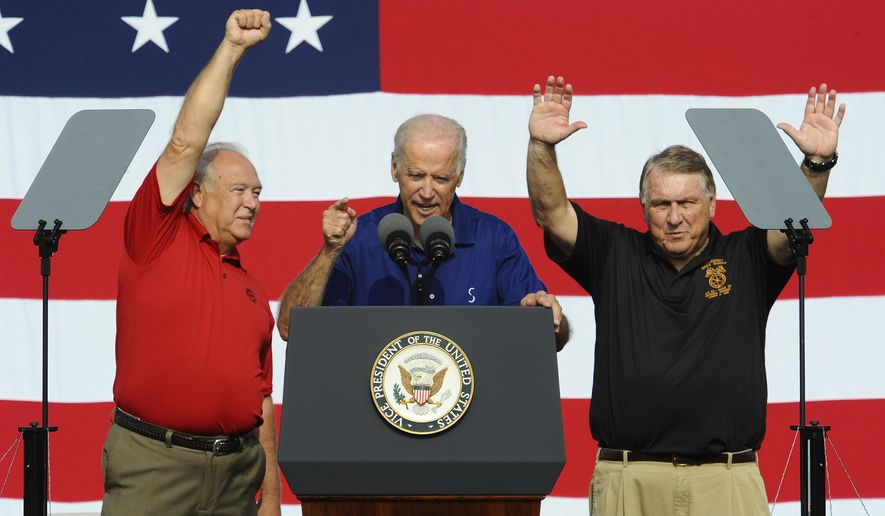 From left, UAW President Dennis Williams, United States Vice President Joe Biden and Teamsters President James Hoffa address the crowd before the start of the Labor Day Parade, at the site of old Tiger Stadium, in Detroit on Monday, Sept. 1, 2014. (AP Photo/The Detroit News, Daniel Mears, Pool)