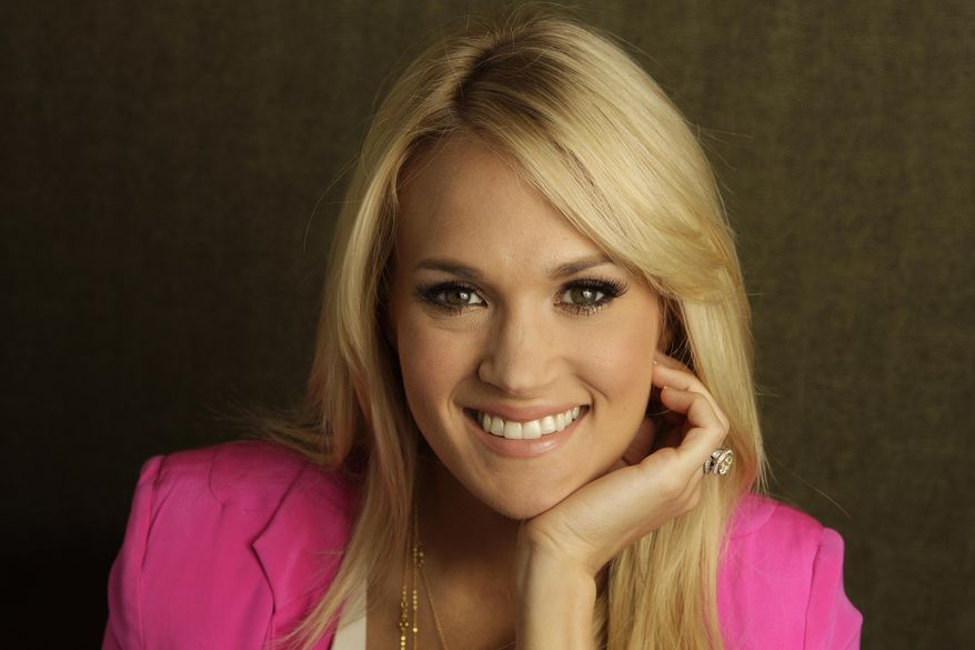 FILE - This April 19, 2012 file photo shows Carrie Underwood in Nashville, Tenn. Country star Carrie Underwood and NHL player Mike Fisher announced Monday, Sept. 1, 2014 that they are expecting their first child. (AP Photo/Mark Humphrey, File)