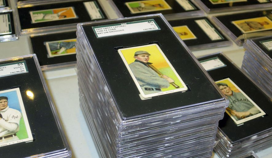 In this Aug. 25, 2014 photo, a 1909 baseball card depicting Ty Cobb is seen at Saco River Auction Co., in Biddeford, Maine. The card is part of a collection of more than 1,400 baseball cards from 1909, 1910 and 1911 that will be auctioned off starting in January 2015. (AP Photo/David Sharp)