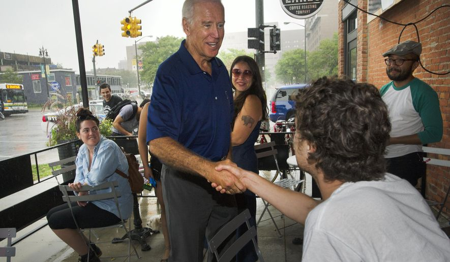 Vice President Joe Biden visits with customers at the Great Lakes Coffee Roasting Company where he had a cup of coffee and something to eat following his speech before the start of the Labor Day Parade at the site of old Tiger Stadium in Detroit, Monday, Sept. 1, 2014. (AP Photo/The Detroit News, Daniel Mears, Pool)