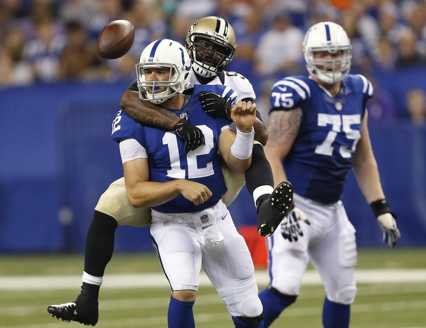 FILE - In this Aug. 23, 2014, file photo, Indianapolis Colts quarterback Andrew Luck (12) loses the ball as he's sacked by New Orleans Saints outside linebacker Junior Galette during the first half of an NFL preseason football game in Indianapolis. The Colts aren't be sure what the offensive line will look like Sunday, Sept. 7, against Denver.  (AP Photo/Sam Riche)