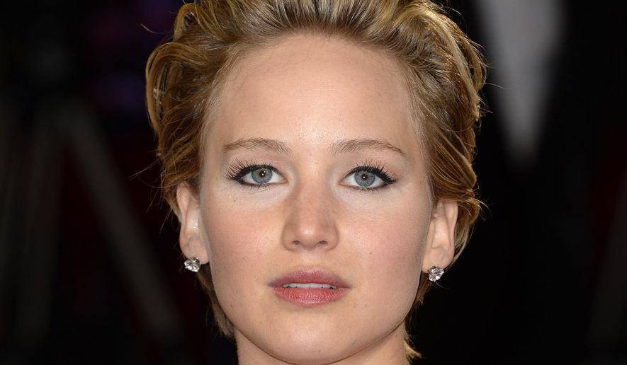 FILE - In this Sunday, March 2, 2014, file photo, Jennifer Lawrence arrives at the Oscars at the Dolby Theatre in Los Angeles. A publicist for Lawrence says the actress has contacted authorities after nude photos of her were apparently stolen and posted online. Intimate images of the Oscar-winning actress began appearing online on Sunday, Aug. 31, 2014, and nude images purported to be of other female celebrities were also being circulated online. The source of the leak was not immediately known.  (Photo by Dan Steinberg/Invision/AP, File)