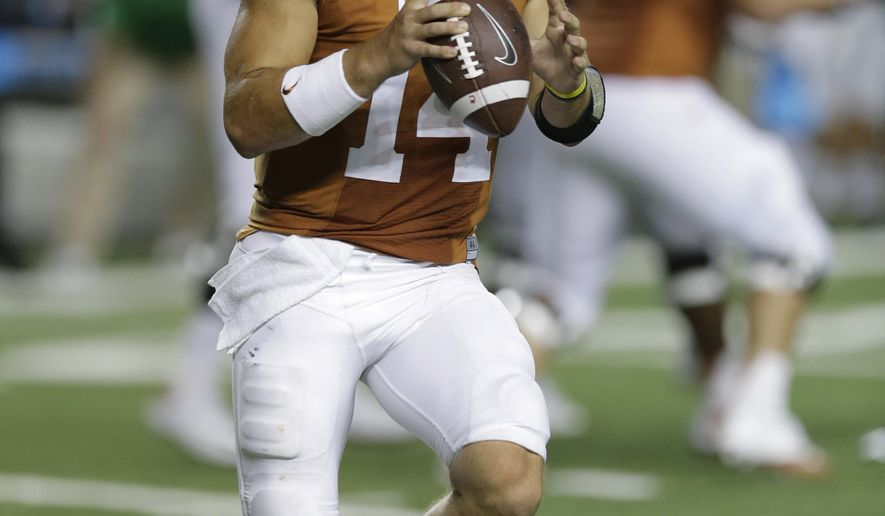 Texas' David Ash (14) looks to throw against North Texas during the second half of an NCAA college football game, Saturday, Aug. 30, 2014, in Austin, Texas. (AP Photo/Eric Gay)